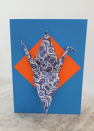 A Pop of Colour #2 (orange) Blue and white Paper Crane on textured blue card