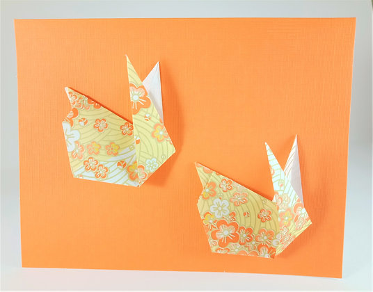 Easter theme card -  Two bunnies on an orange background