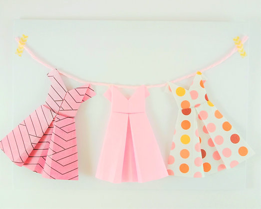 Three little dresses on a line - pink and polka dot theme