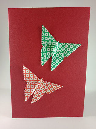 Christmas Card - red, green geometric dot butterfly on red card