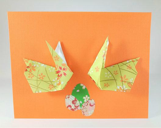 Easter theme card -  Two bunnies, three eggs, orange background