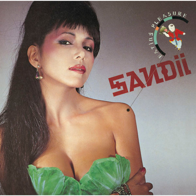 """Cover of Sandii's album """"Eating Pleasure"""", featuring Sandii herself wearing a low cut top with leafy bra cups"""