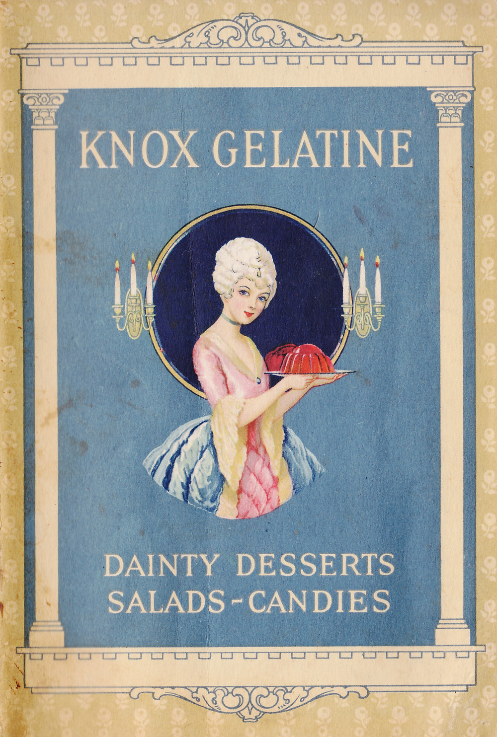 Cover of Knox Gelatine recipe booklet, featuring an illustration of a woman dressed in Rococo fashion framed by Neoclassical pillars