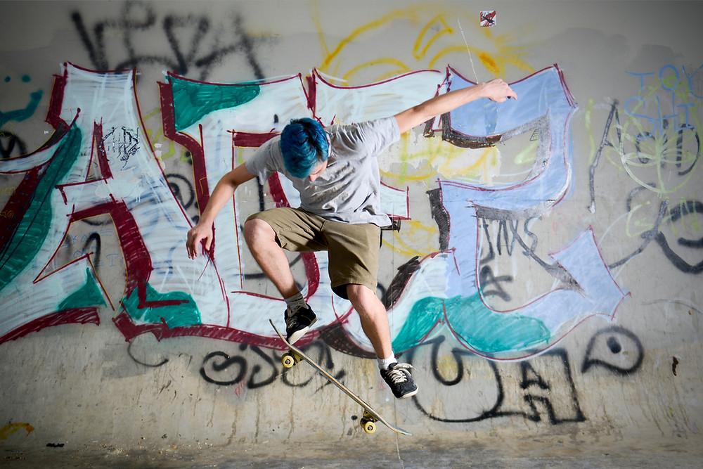 Skatepark Graffiti and skateboarder ollie