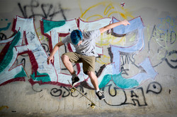 skater performing an olie on a skateboard