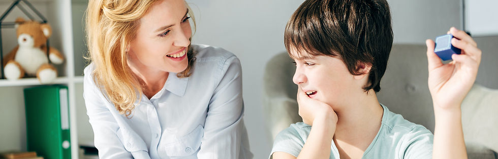 A young boy and woman talk