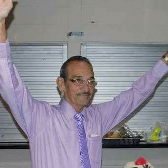 My Dad on his 80th birthday, arms raised, smiling