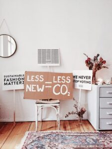 home office with less new equals less CO2 sign on chair