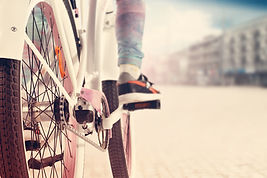 pedaling a bicycle