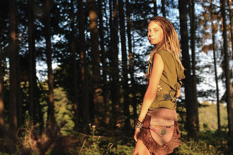 Alternative nature girl with dreadlocks,