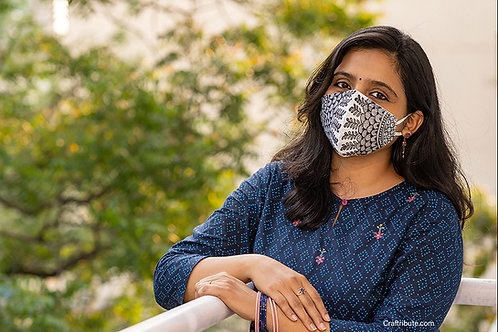 Girl wearing Madhubani design hand painted cotton mask with delicate floral design