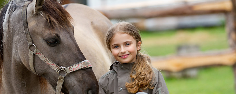 Youth girl smiling and grulla horse