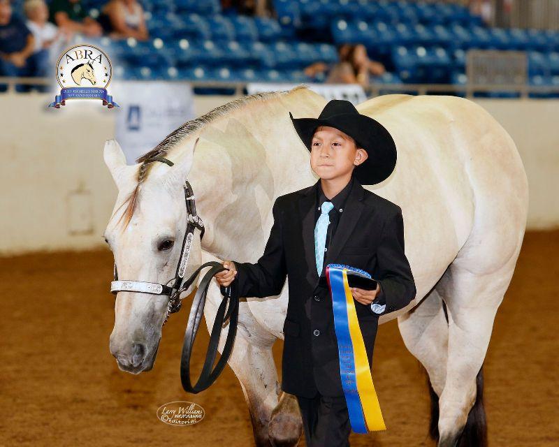 boy and buckskin horse, ribbon award