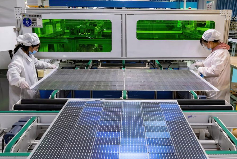 Workers produce solar panels for export to Africa and Southeast Asia