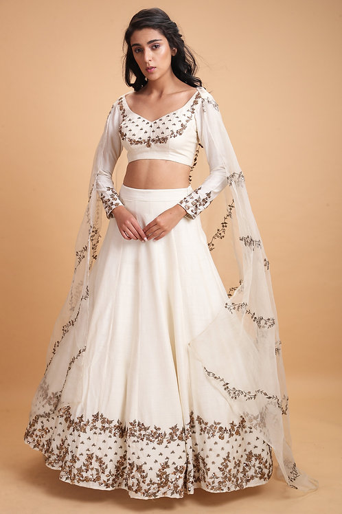 White silk Lehenga with dark gold work