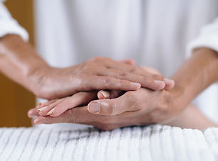 holding-hands-at-reiki-healing-treatment