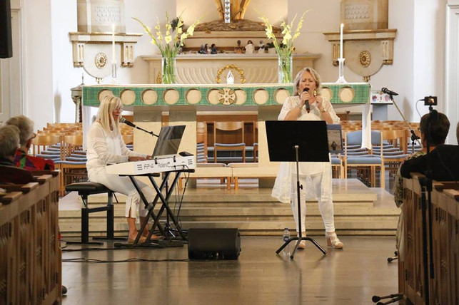 Lena in concert at Cathedral in Sweden. On piano Rut Larsson