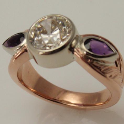 white and rose gold ring w/ bezel set gems