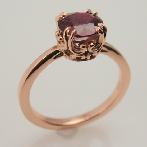 Ruby and rose gold solitaire