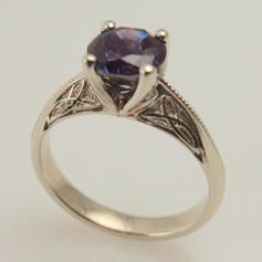 blueish purple sapphire w/ celtic trinity knot solitaire