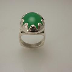 big green gem w/ silver scaloped bezel