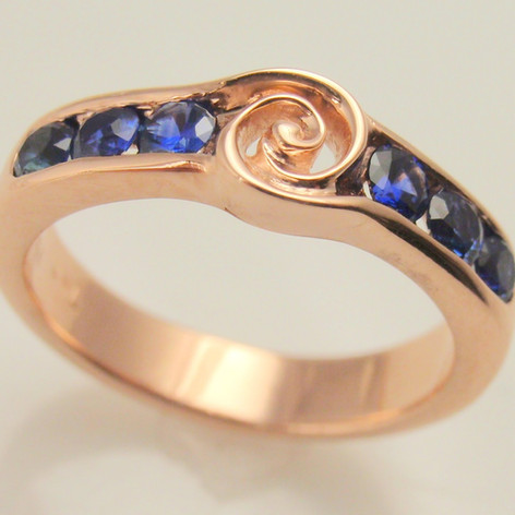 twisy center ring w/ sapphire channel accents