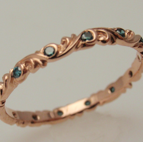 Colored diamond and sapphire engraved band