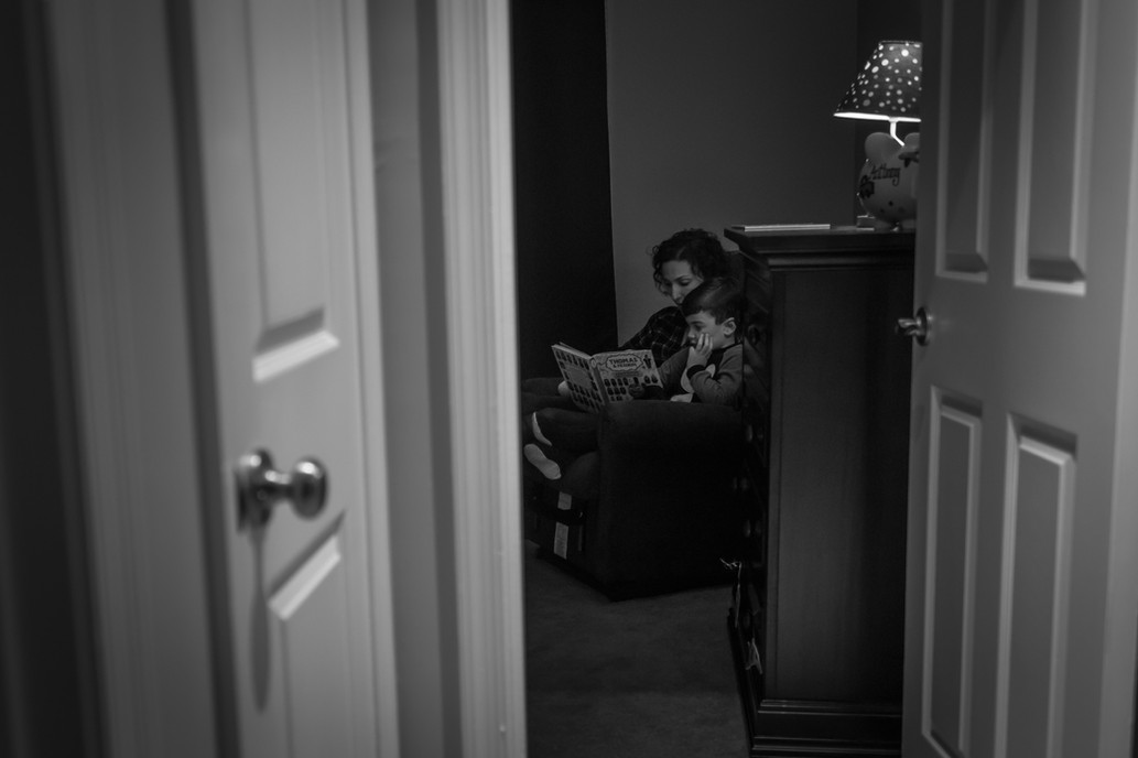 Mother reading a bedtime story to her son.