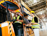 warehouse-workers-working-together-with-