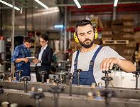 young-bearded-mechanic-in-protective-headphones-re-HZ8VA4K.JPG