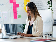 confident-business-woman-working-with-computer-whi-EAHJR9C.jpg
