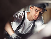 a-young-mechanic-is-concentrated-on-his-