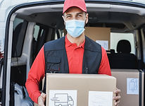 courier-driver-man-delivering-package-while-wearin-TJ69WZH.jpg