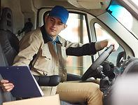 man-delivering-parcels-by-the-van-5Y2E6D