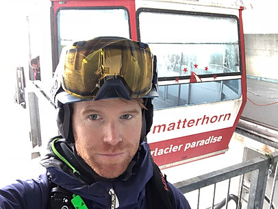 A picture of Chris Winters in front of the Klein Matterhorn Cable Car in Zermatt, Switzerland