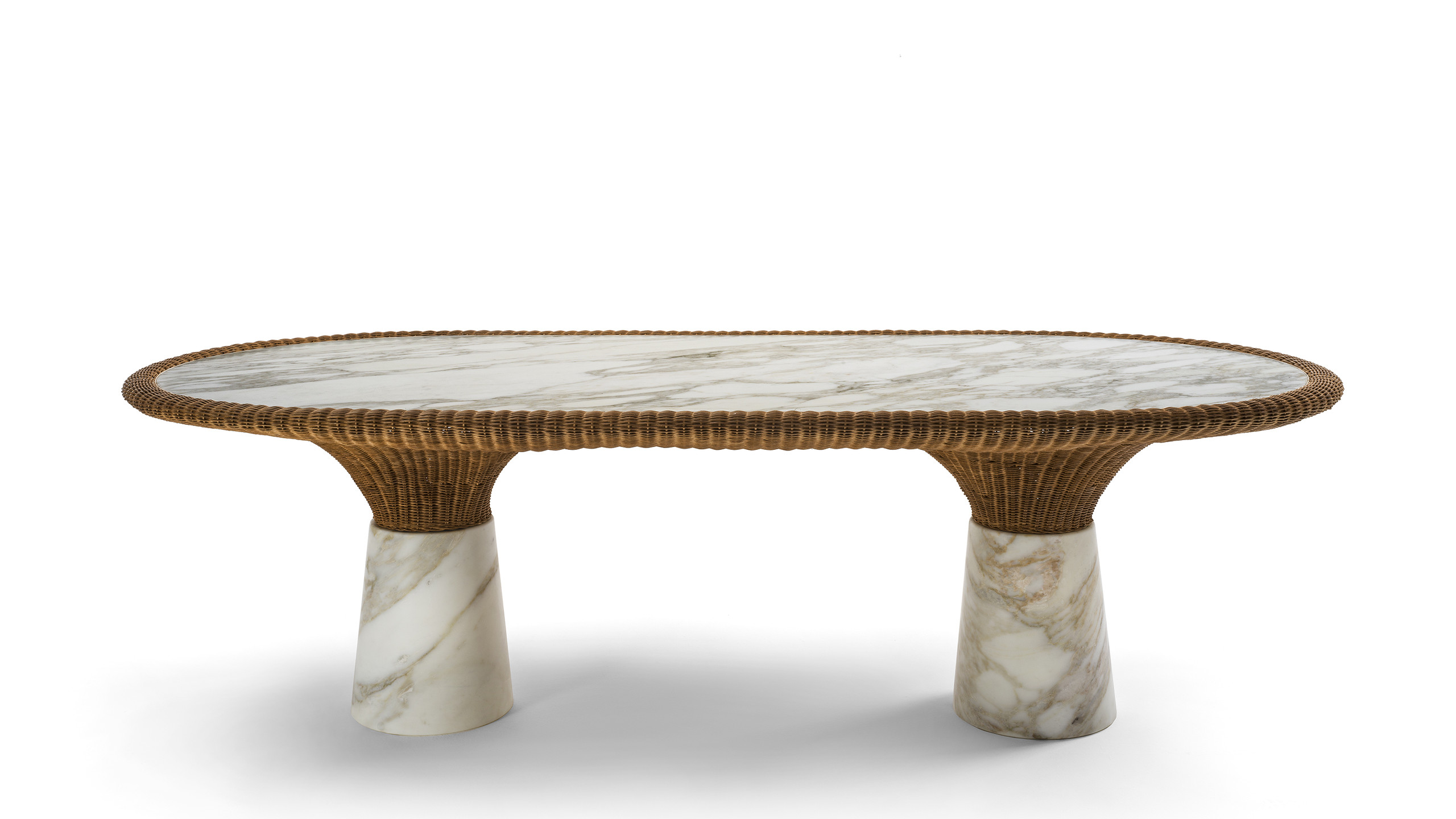 "The ""Amazonas"" collection disegned by Bonaguro represents the debut of Morfosi in the Outdoor area. Characterized by the use of marble combined with wicker, it is inspired by the luxuriant and exuberant nature of Brazil. As the vegetation of rainforest flows and spreads from the earth to the light, so the wicker is born from the marble and creates sinuous and elegant shapes that incorporate and support the stone. Two natural materials that are not simply combined, but intertwine to create new furnishing elements."