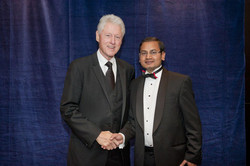 With Mr Bill Clinton