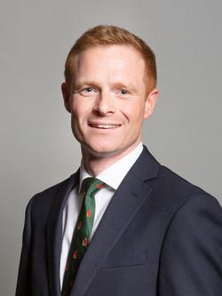Mr Robbie Moore MP