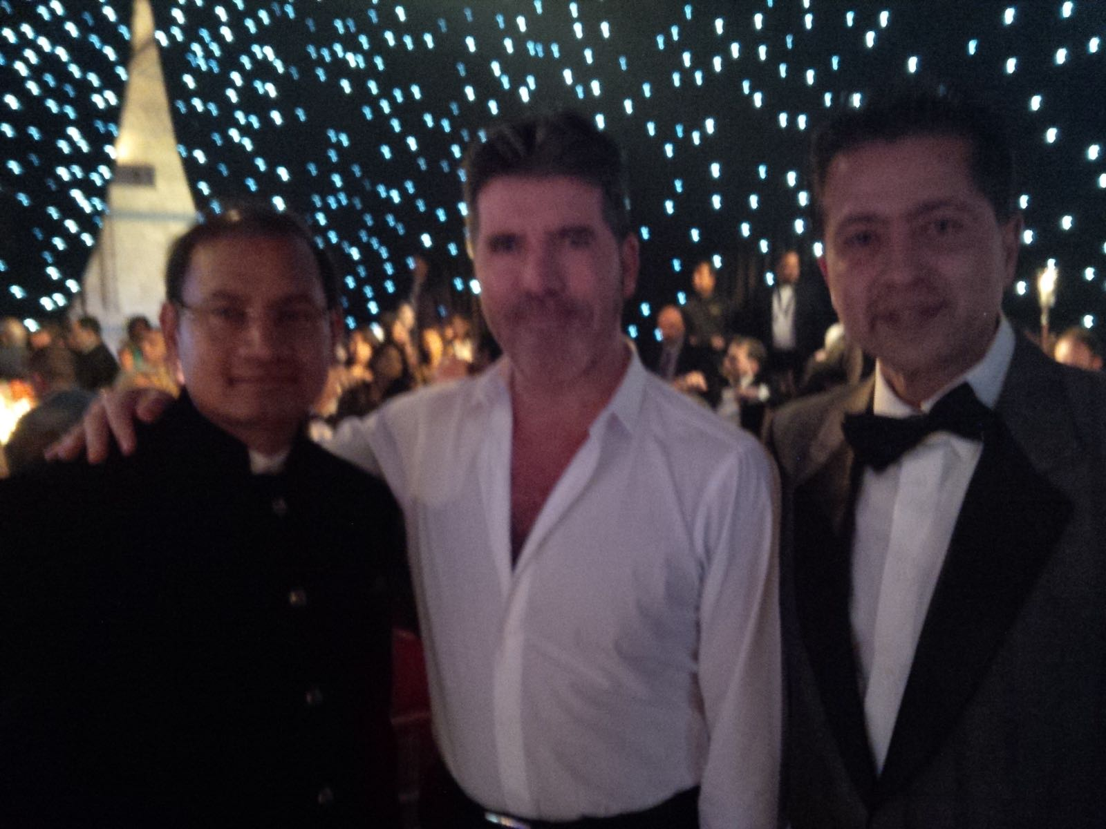 With Simon Cowell