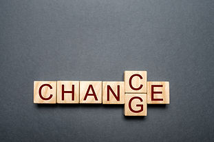 Wooden cube with word change to chance o