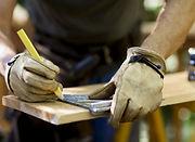 Carpenter Measuring Wood_edited.jpg