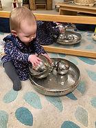 Maisie in Baby room.jpg