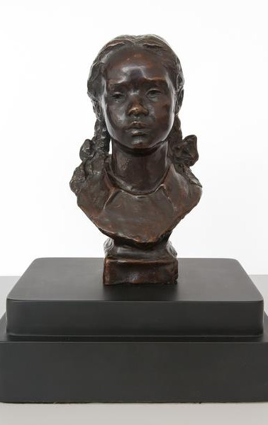 Girl with pigtails c. 1935