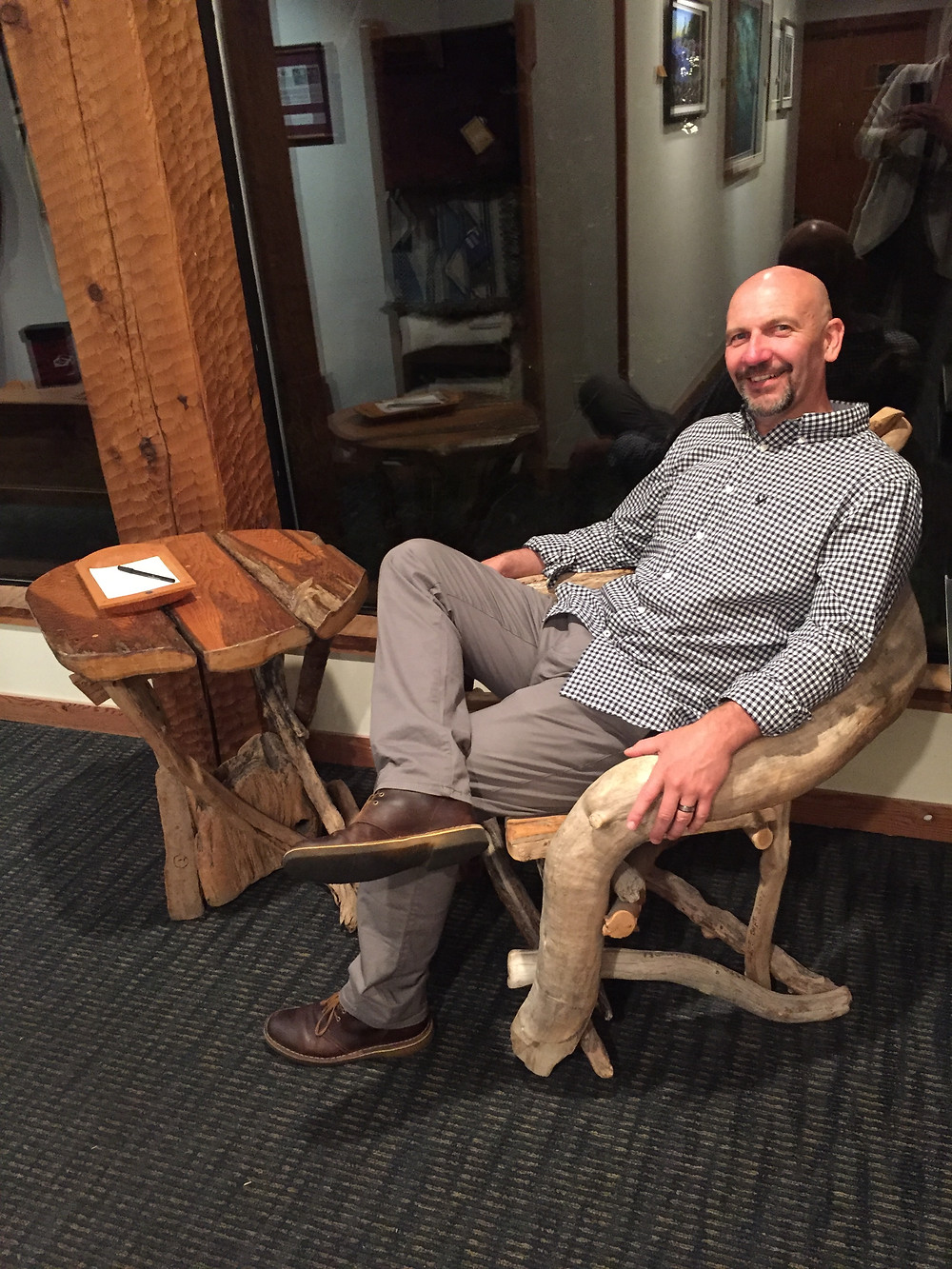 man sitting in driftwood chair at the Wickaninnish Inn in Tofino BC