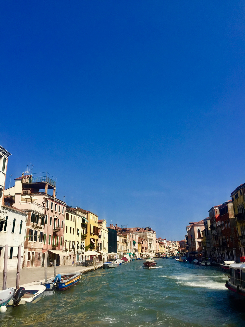 View from boat leaving Venice Italy in the summer on the Grand Canal