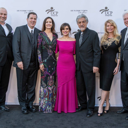 Group photo of 7 adults at UCP-OC's Life Without Limits Gala