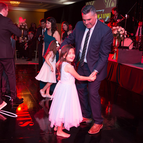 Photo of children and parents dancing at UCP-OC's Life Without Limits Gala