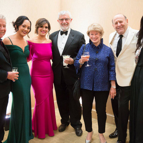 Group photo of 7 individuals at UCP-OC's Life Without Limits Gala