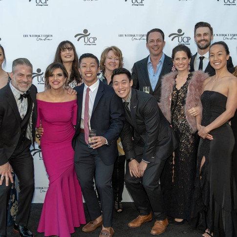 Photo of 12 individuals smiling at UCP-OC's Life Without Limits Gala