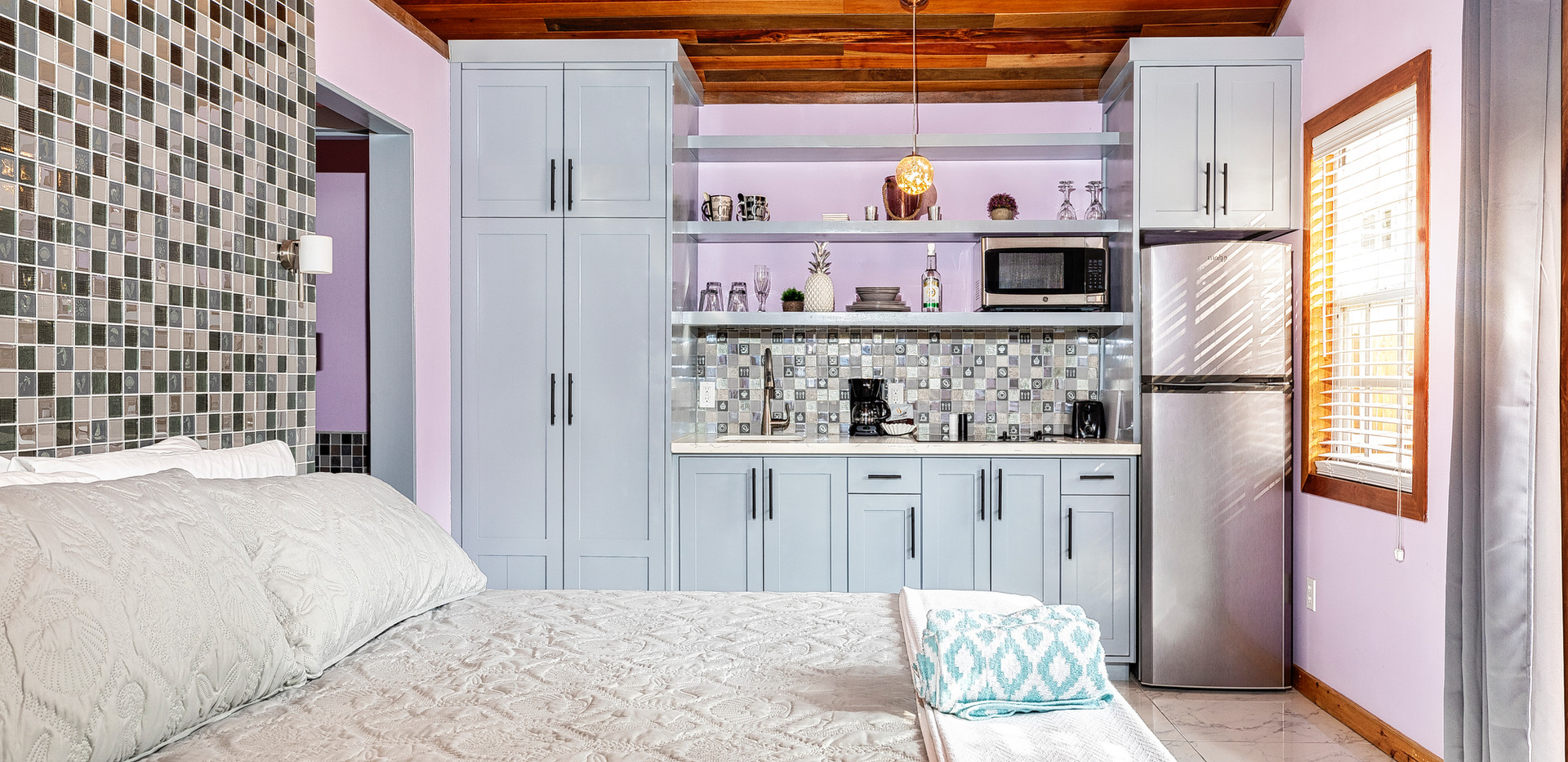 Casita king bed and kitchen